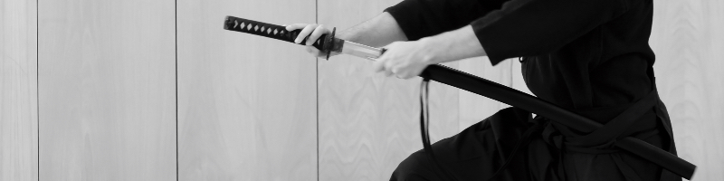 After hitting the imaginary oponent with the hilt of the sword, a Iaido student starts to unsheath the sword